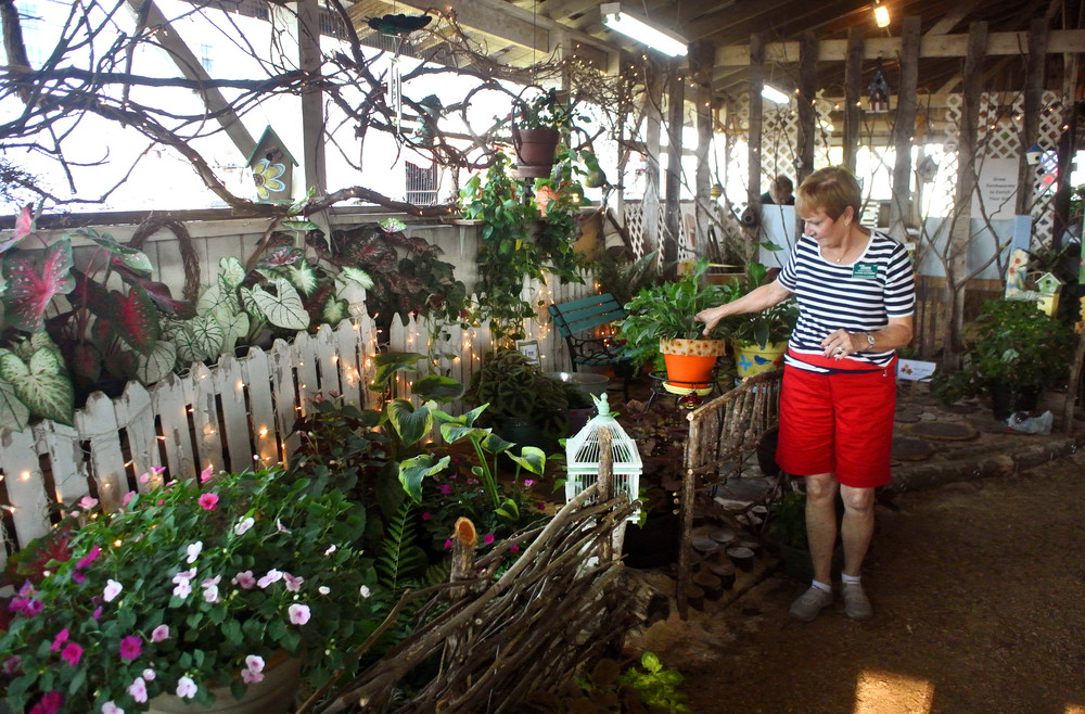 Master Gardener Sandi Koczwara-Farris keeps an eye on some of the plants in the Master Gardener exhibit at the fair. Friday's main attraction is the monster truck rally at 6:30 p.m. On Saturday, the pet show is set for 8:30 a.m. in the music barn, a spirit jam at 9 a.m. in the main arena, a cruise-in from 9-10 a.m. in the north parking lot, roping demo and practice from 2-4 p.m. in the east arena, the Middle Tennessee Junior Rodeo at 4 p.m. in the east arena and mud truck racing at 6:30 p.m. in the main arena.
