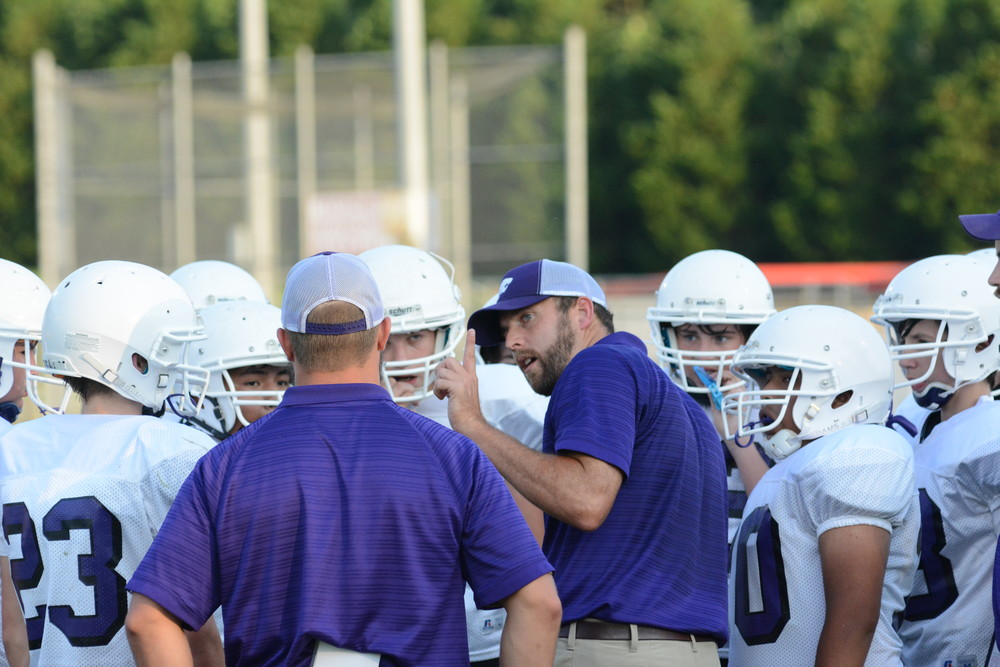 Monterey Middle School coach Kyle Childress, center, gives his team instruction during a break in the action Thursday.