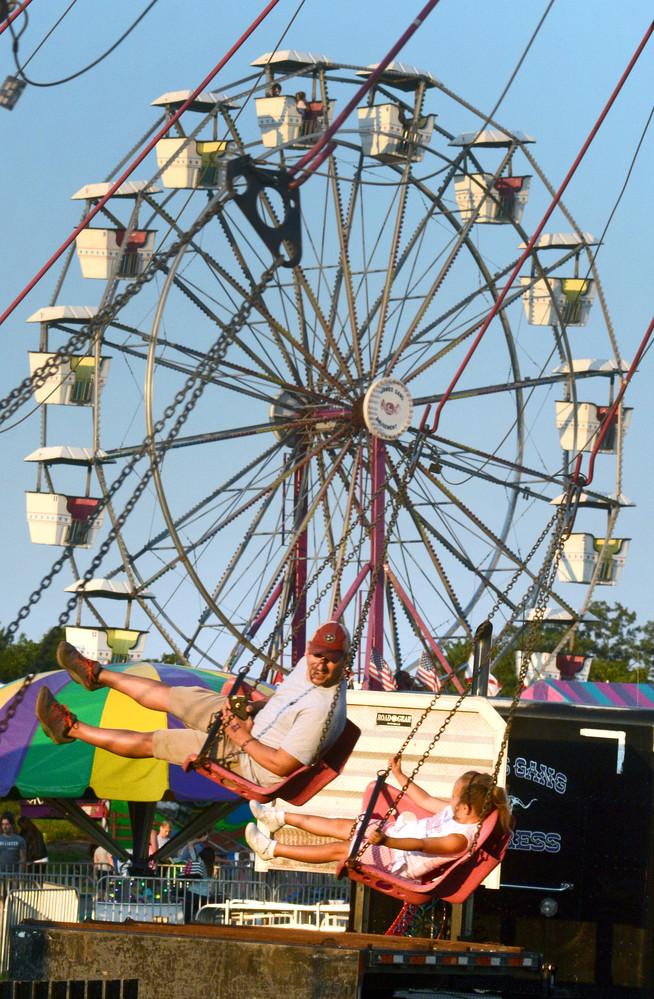 William Overstreet and his five-year-old daughter, Willow, enjoyed a ride on the swings at this year's Putnam County fair which wrapped up last night.