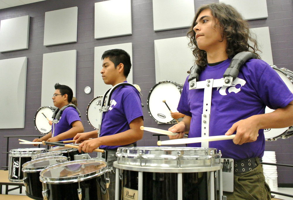Monterey High School students, from left, Erbin Perez, Ivan Agustin and Jesse Vaughn rehearse Wednesday as part of the school's resurrected band program.