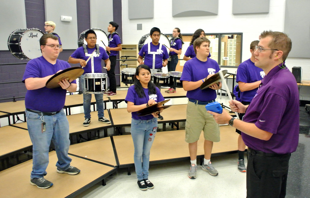 Monterey High School band director Jonathan Holland, at right, leads his band students through a rehearsal Wednesday.