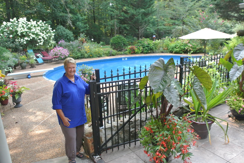 Master Gardener Gloria Vick shows off the beautiful garden surrounding her pool.