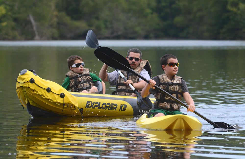 Allen Matherly, 9, left, and Alexander Matherly , 10, enjoy a day kayaking at Cane Creek Park with their father, Brad. The park has paddle boats for rental, a disc golf course, mountain bike trails, volleyball and basketball courts, along with walking trails as well as shelters for rent. After Labor Day, the park will be open from 7 a.m. to 9 p.m.