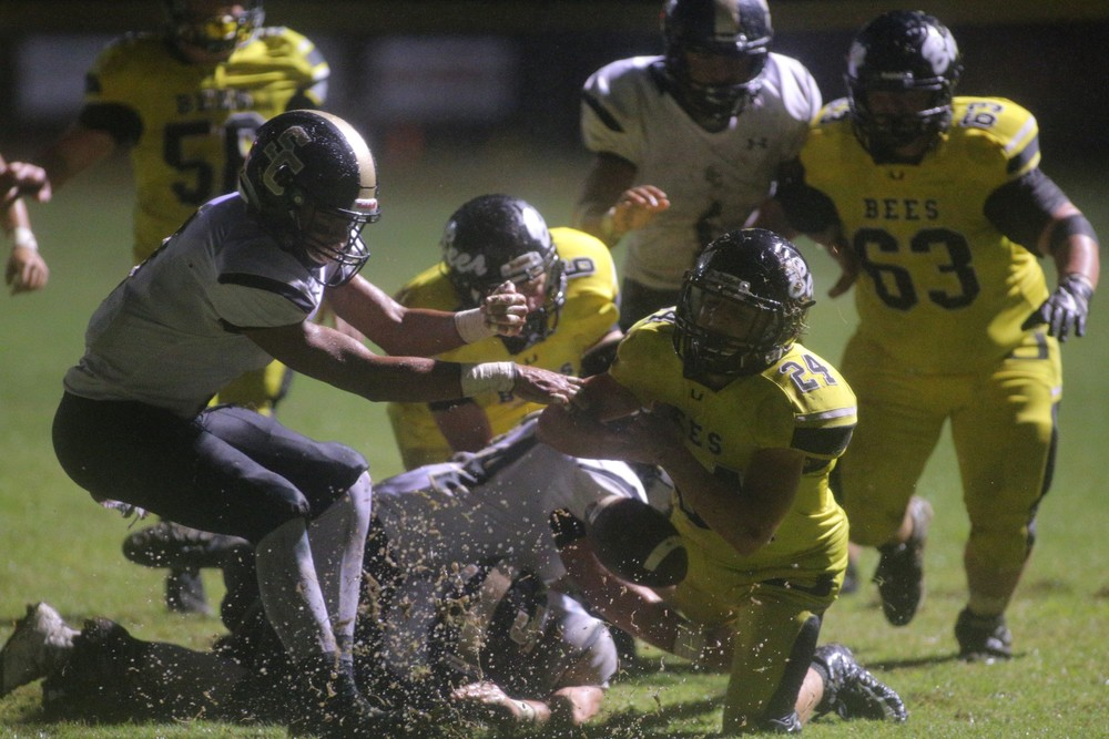 Upperman's Blake Metzgar, right, tries to grab the loose ball during the Bees' game with Smith County Friday. The Owls recovered the fumble and went on to win the game, 21-0.