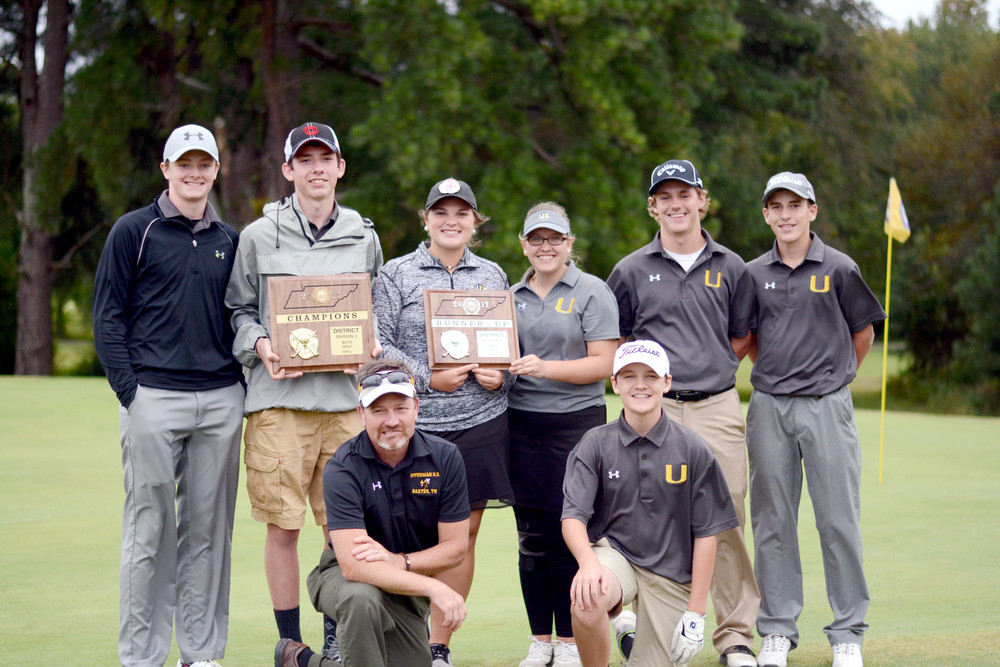 The Upperman High School golf team finished first and second Monday at the district tournament. The boys won the title, slipping by Clay County and Monterey; while the girls finished second. The team includes, front row, from left: coach Jason Holcomb, Cason Mayberry; back row: Reece Anderson, Colton Smith, Juliann Johnson, Hailey Jennings, Mason Haggard and Clay Daniels.