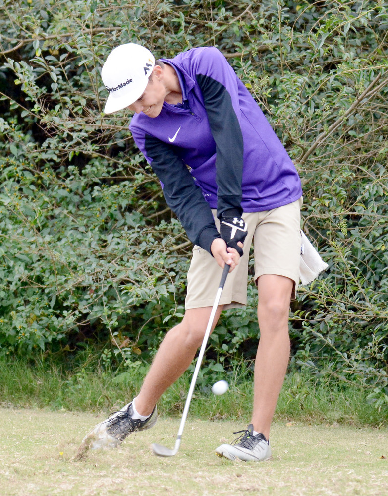 Monterey's Cade Painter hits an approach shot.