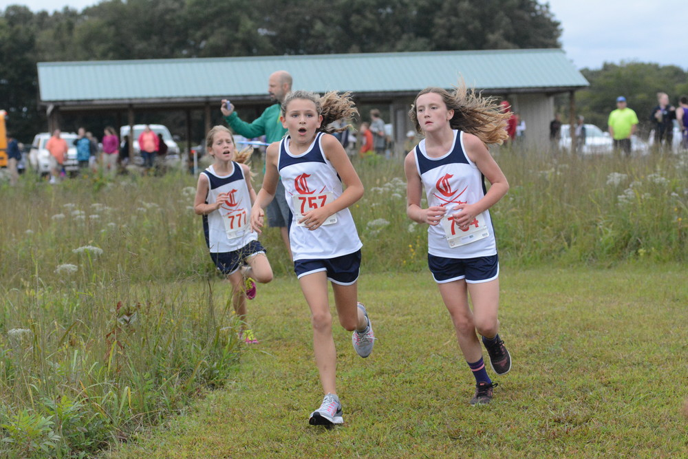 Cookeville runners head to the finish line. They are, from left: Peyton Murdock, Sarah Coonce and Danielle Hammock.