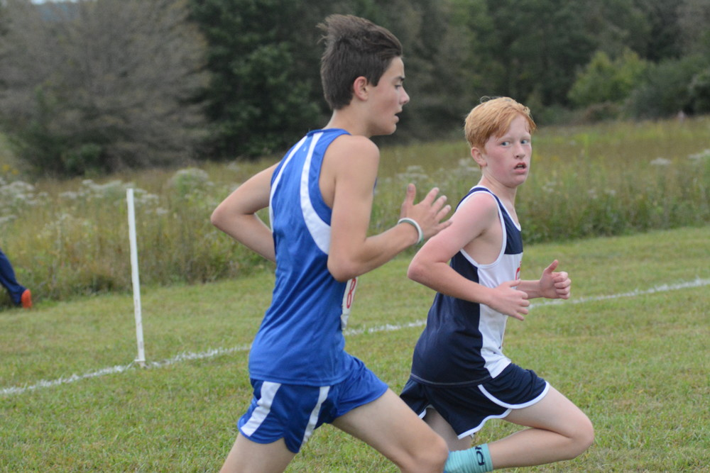 Cookeville's Miles McReynolds, right, looks back at a Macon County runner.