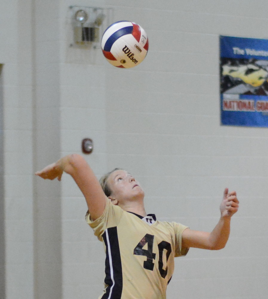 Addie Adams serves for the Upperman Lady Bees during their match Tuesday with Smith County.