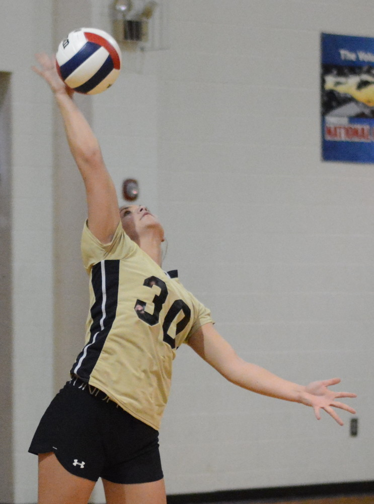 Reagan White fires a ball over the net during her service in Upperman's match with Smith County.