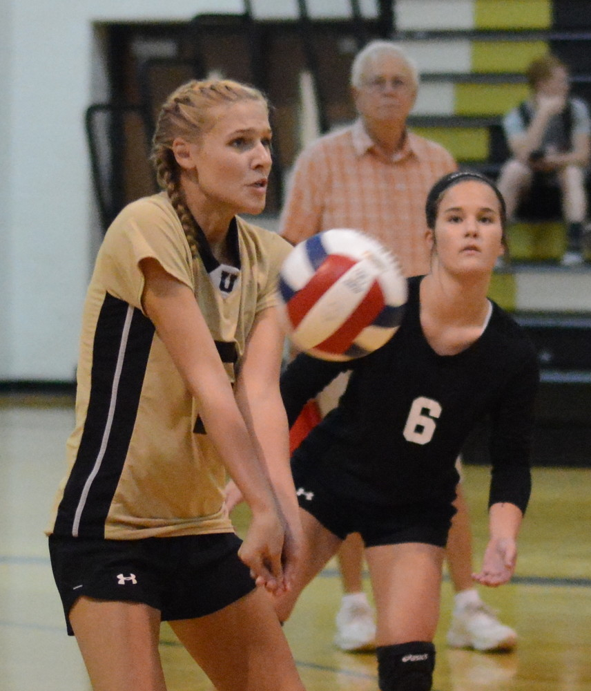 Sydney Haggard receives serve for the Upperman Lady Bees during action Tuesday with Smith County.
