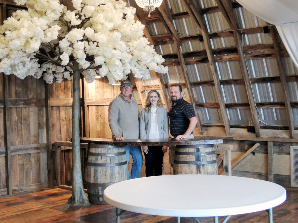 Enjoying the space in the new loft area, from left, are Ed Buck, Saltbox Inn owner; Randi Barksdale, business development director; and Dave Matlock, creative director.