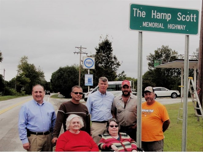 At the dedication of a section a section of Highway 85 in memory of Hamp Scott are, in front, from left: Marie Scott, widow of Hamp; and Teresa Scott, a daughter. In back, state Sen. Paul Bailey; Harold Scott, son; state Rep. John Mark Windle; Matt Scott, a grandson; and Tim Scott, son.