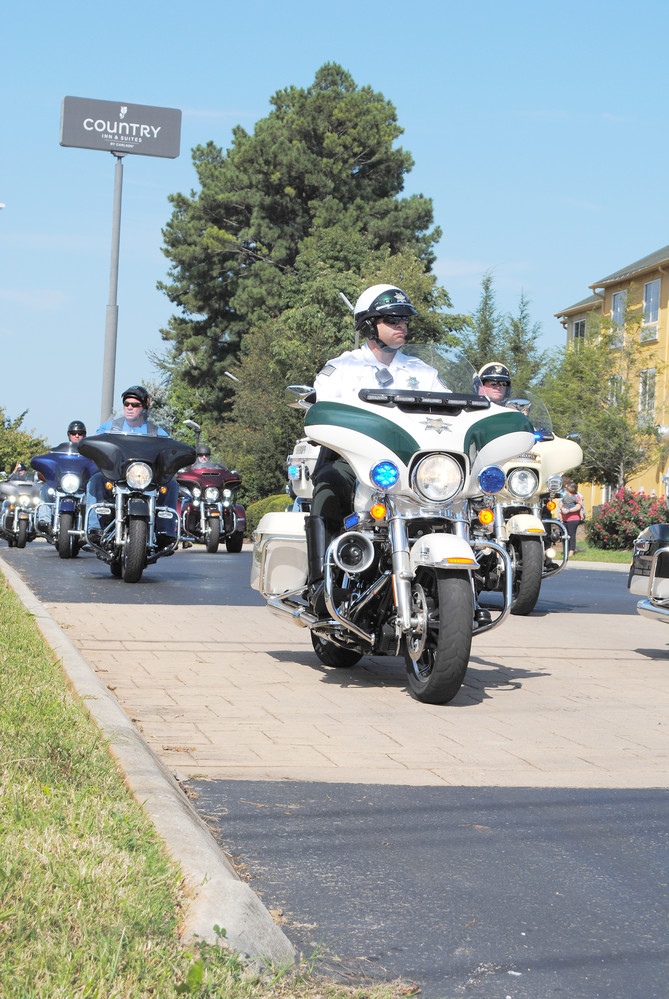 Putnam County Sheriff's motorcycle deputies lead the Jerry Dale Abston Memorial Ride Saturday.