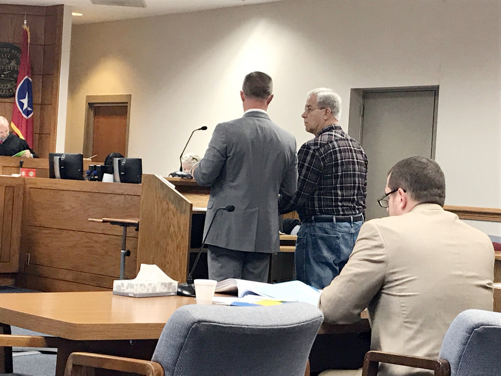 Roy Loutzenheiser listens to his attorney, Wesley Bray, in the Putnam Criminal Courtroom of Judge Gary McKenzie Monday morning during his plea hearing. Thirteenth Judicial District Attorney Bryant Dunaway is at right.