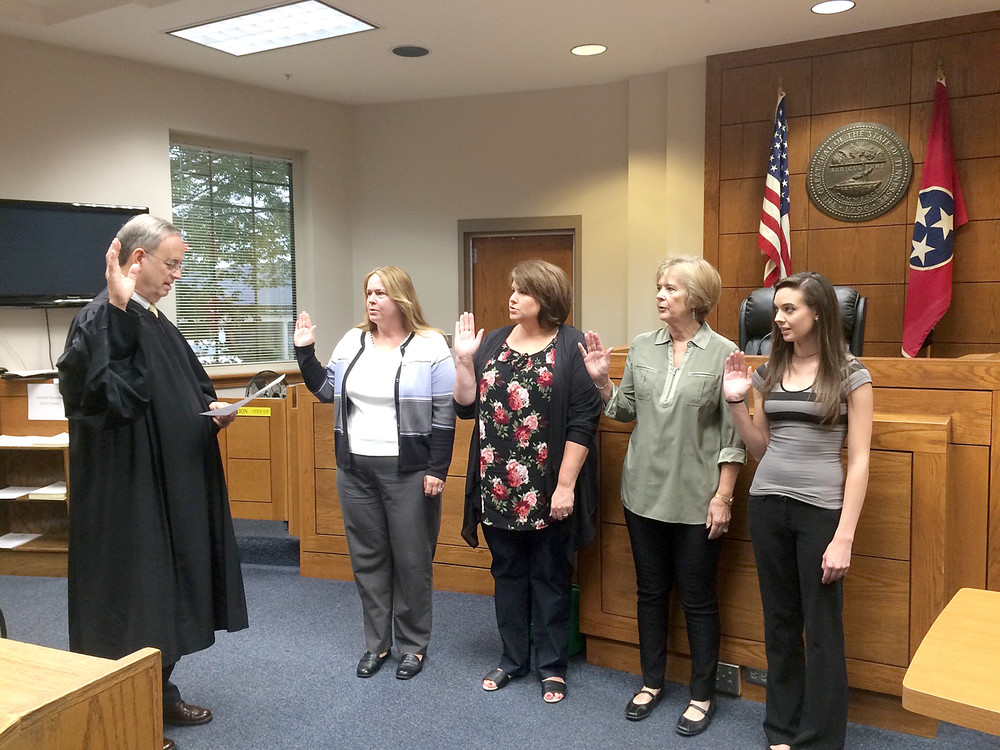 Four new Court Appointed Special Advocate members were sworn in last week by Putnam County Juvenile Judge John Hudson, left. They are, from left, Lorraine Bullock, Tonya Strong, Carol Nahm and Chelsea Elrod, who is a Tennessee Tech student and an intern at CASA this semester. For more information on CASA, call 520-9542.
