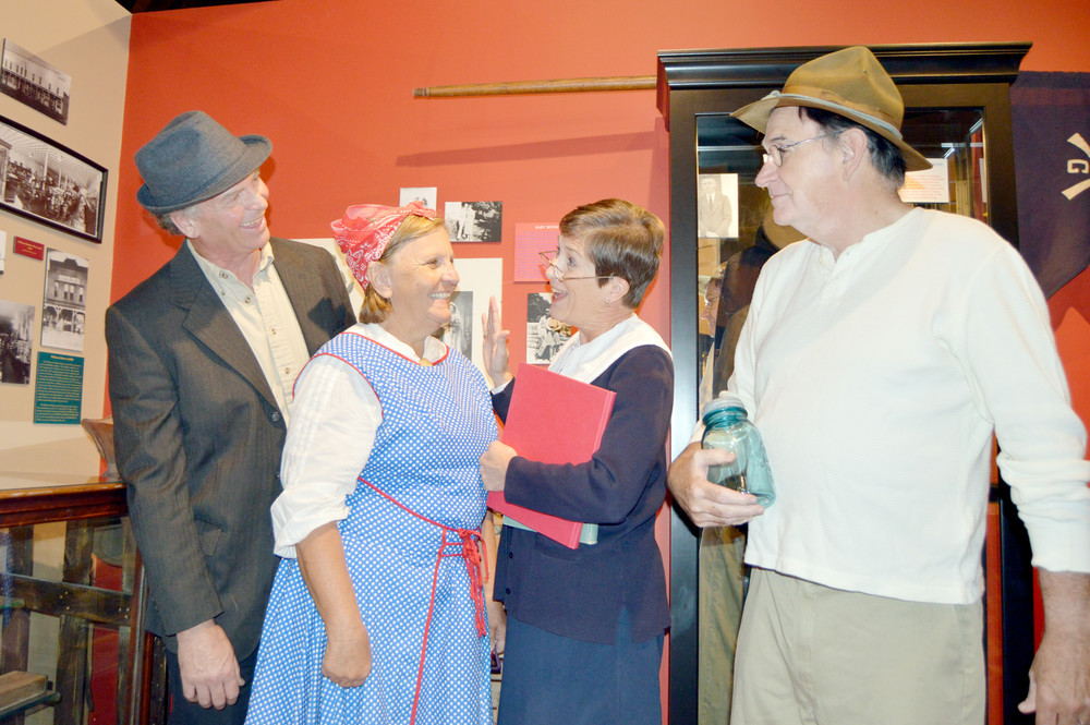 Don and Julie Bohannon, playing Monterey citizens, talk with Jan Presley, playing a Baxter Seminary teacher, and Dwight Henry, playing a Waterloo moonshiner, in preparation for Cookeville's Night at the Museums Saturday.