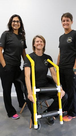 Shehla Rooney, Sonya Briggs and Nikki Orazine with their new device, the Go-Knee.