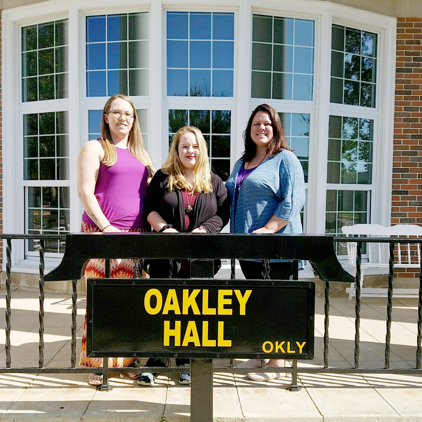 TTU students Valerie Caswell, Shelby Brock and Latisha Scarlett stand in front of Oakley Hall, where they plan to have a permanent box for food donations for students at risk of going hungry.