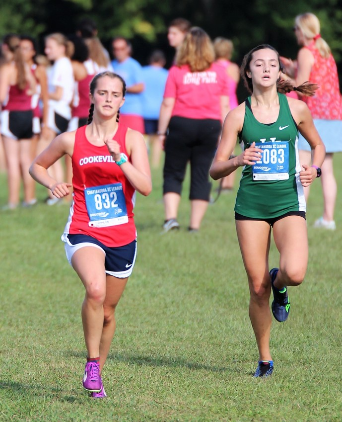 Cookeville High School's Emma Cate Jones, left, pushes to the finish line during a race earlier this season. According to the numbers, Jones is getting better every season since joining CHS as a freshman.