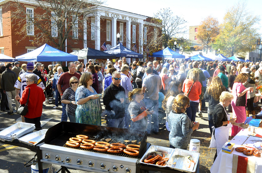 Crowds line up at a past Cooking on the Square to benefit Putnam County Habitat for Humanity in front of the Putnam Courthouse.