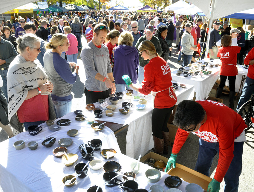 Cooking on the Square participants select bowls to fill with gumbo during a previous event.