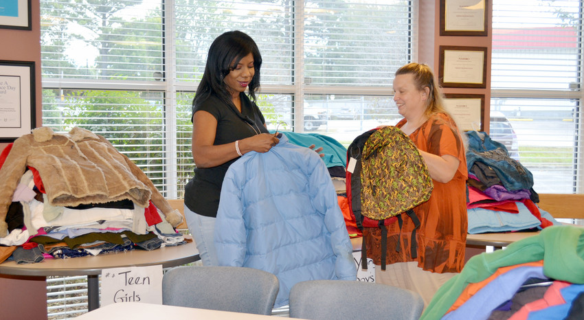 Shaquawana Wester, left, and Misty Parker sort through coats and backpack donations being put together for the Quawana's Coats and Homeless and Hunger events being held Oct. 28.