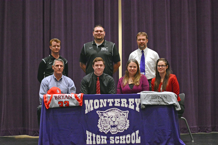 Monterey's Michael Cody, front center, signs his letter of intent to play basketball for Bryan College. The signing was witnessed by (front row, from left) Tim Cody, Jo Cody, Margaret Cody, (back row, from left) Bryan College head coach Don Rekoske, Bryan College assistant coach Bryon Lawhon, and MHS head coach Adam West.