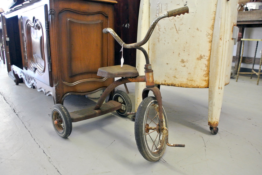 A rusted tricycle is one of the many discoveries John Owen has in his shop.