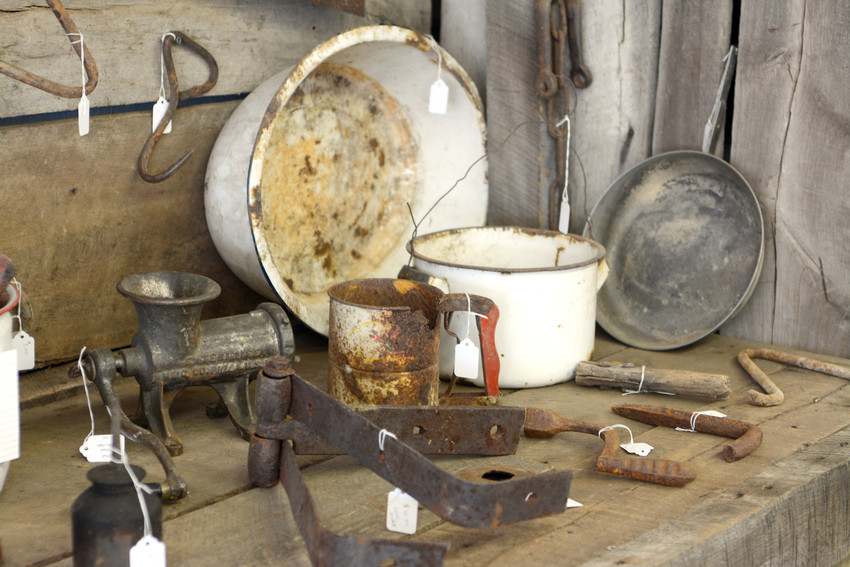 Pots and pans and other contraptions from years past sit on display in John Owen's shop.