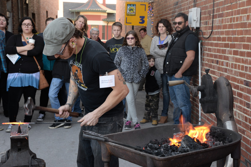 Abe Pardee demonstrates blacksmithing during the ART Prowl .