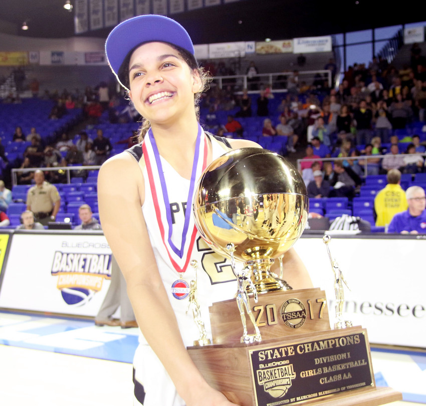 Upperman's Akira Levy poses with the TSSAA Class AA State Championship trophy in March at MTSU.