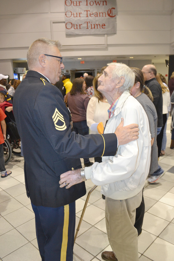 JROTC Sgt. David Frazier talks with 93-year-old Dallas Melton of Algood, a World War II veteran of the U.S. Navy.