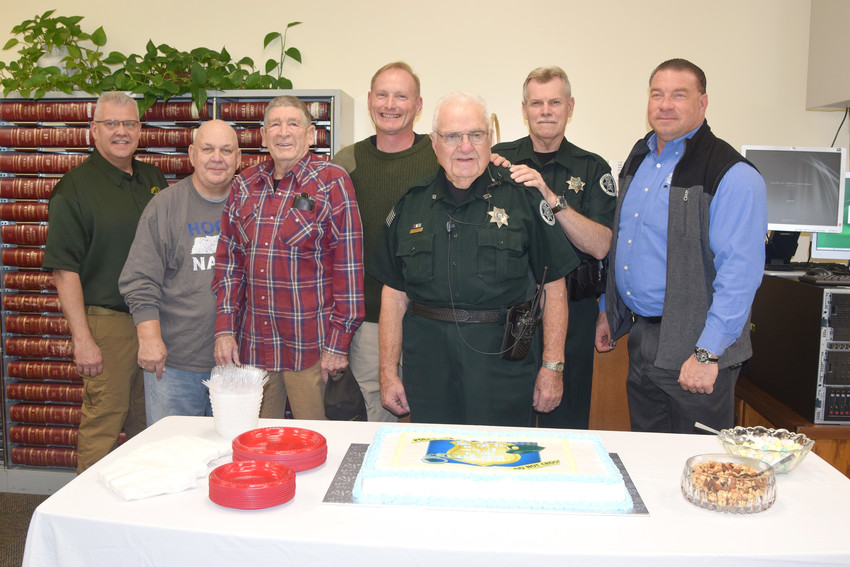Celebrating Putnam County Sheriff's Office Court Officer Bob Errick's 90th birthday, from left, are Major Tim Nash; court officers Steve Mackie, Raymond Tallent, Pat Stickler, Errick and Mark Webb; and Sheriff Eddie Farris.