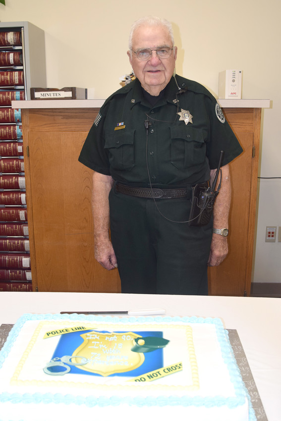 Putnam County Sheriff's Office Court Officer Bob Errick celebrates his 90th birthday at the Putnam County Justice Center this week.