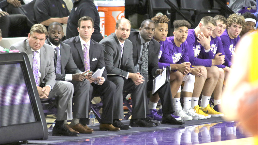 Tech coach Steve Payne, far left, watches the action from the bench. The Golden Eagles host Lipscomb tonight.