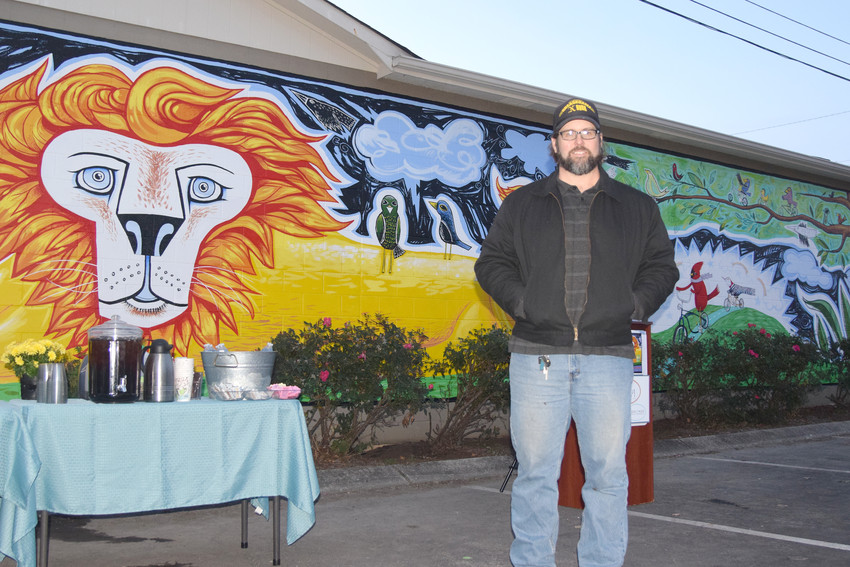Jackson County artist Jason Tingler stands in front of the mural he painted across from the Leslie Town Centre next to the start of the Tennessee Central Heritage Rail Trail.