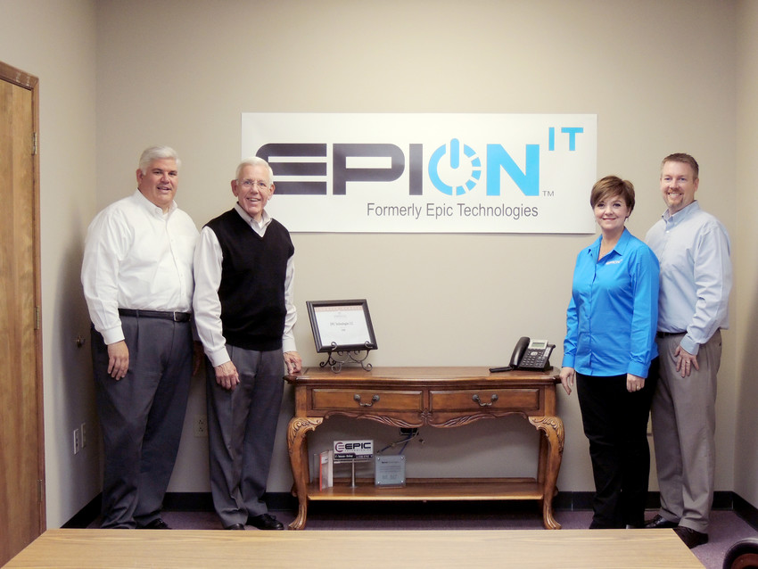 Celebrating the new name of Epic Technologies to EpiON IT, from left, are Don Viar, CEO; Jim Viar, partner; Rebecca Goforth, customer advocate; and Aaron Riddick, director of operations.