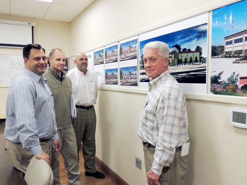 From left, Kevin McCaleb, COO; Andy Stites, vice president; Josh Stites, president; and Jack Stites, CEO, in the design room.