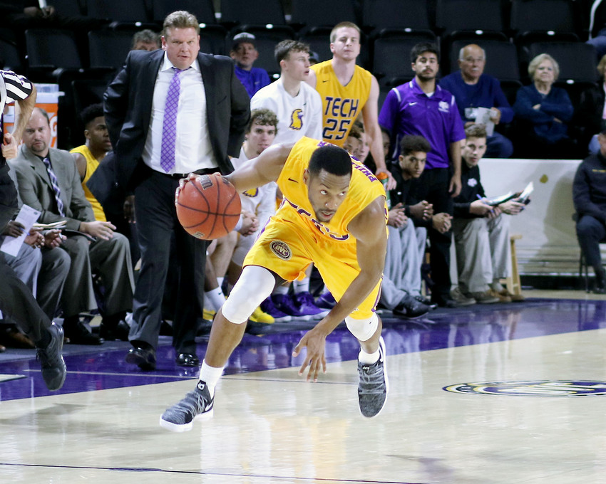 Tennessee Tech forward Curtis Phillips tries to regain his balance during action Saturday against visiting Ken- nesaw State University in the Eblen Center. Phillips and the Golden Eagles held off the talented Owls to pick up a hard-fought victory. Phillips led the way for TTU with 21 points.