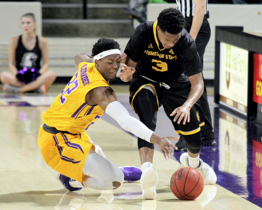 Tennessee Tech's Courtney Alexander, left, dives for a loose ball.