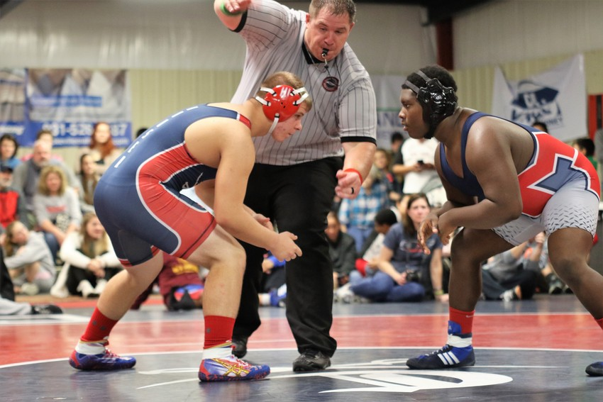 Cookeville's Dyllan Houser, left, squares off against a McGavock wrestler during the Cavs' 54-24 win over the Raiders on Tuesday night at CHS.