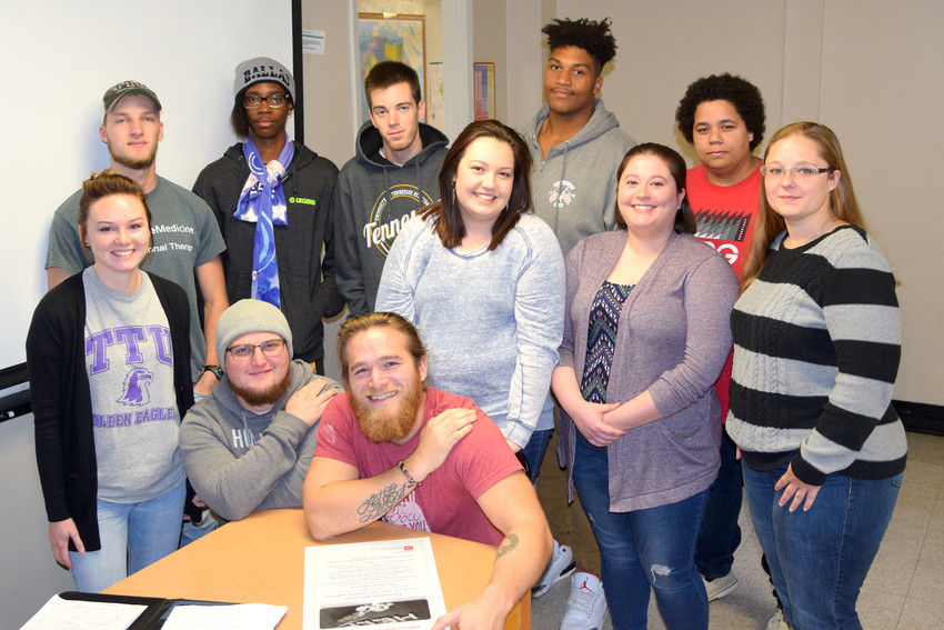Preparing for an education forum on addiction are, seated, from left Jesse Fanning and Nathan Payne; standing, Kesnei Campbell, Dalton Hamlin, Dallas Jackson, Adam Kellerhals, Olivia Gallagher, Eric Kareem, Ashley Carter, Rebekah Taylor and Jennifer Brown.