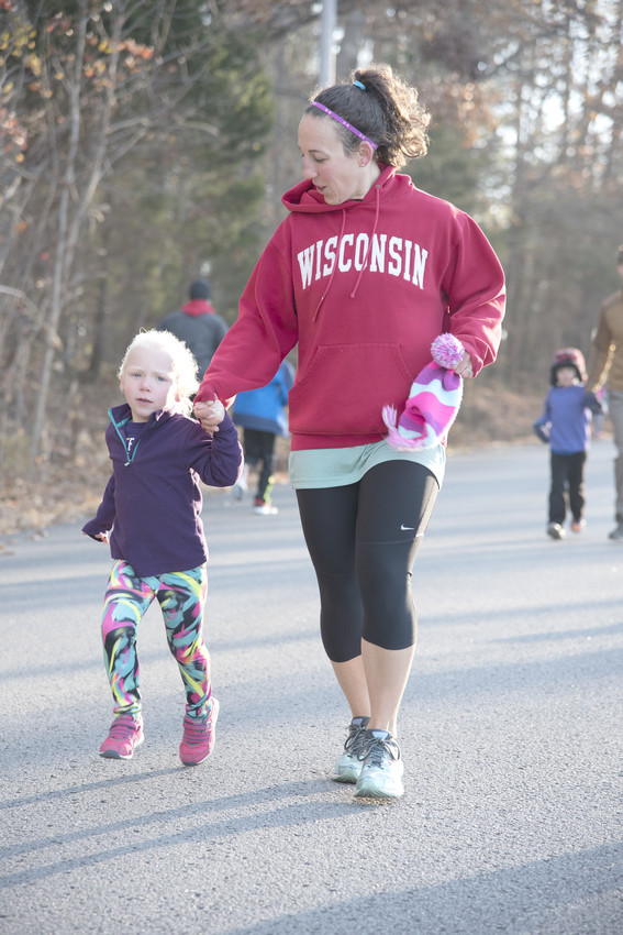 Erin Hedgecloth and her daughter, Paige, take part in the Gobble Wobble preliminary for the Turkey Trot.