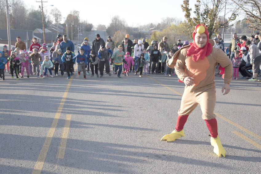 Tyler Bagwell leads the Kids Gobble Wobble at the Turkey Trot.