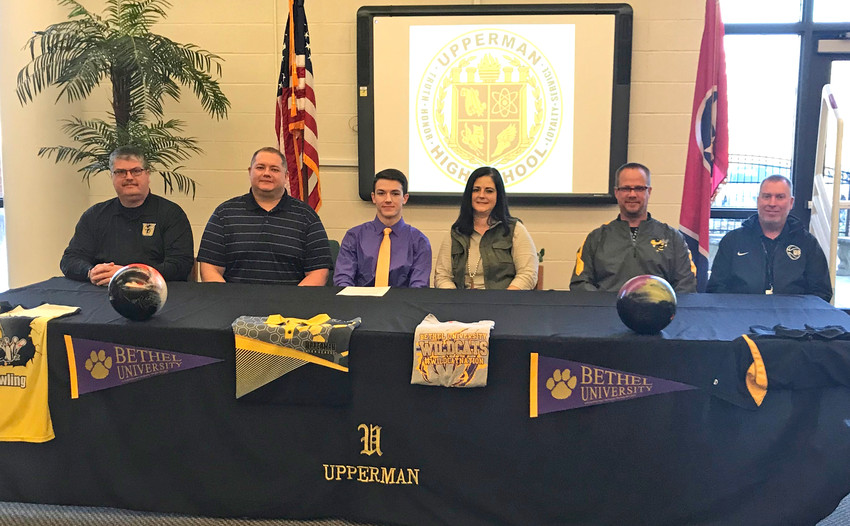Wesley Estep, third from left, recently signed a national letter of intent to bowl next year at Bethel University in McKenzie. Estep, who is actually a senior at Cookeville High School but bowls with Upperman through a cooperative program, was joined for the big day by, from left: Greg Wilson, Upperman High School athletic director; Carl Estep, father; Wesley, Melanie Estep, mother; Brent Green, Upperman High School bowling coach; and Billy Stepp, Upperman High School principal.