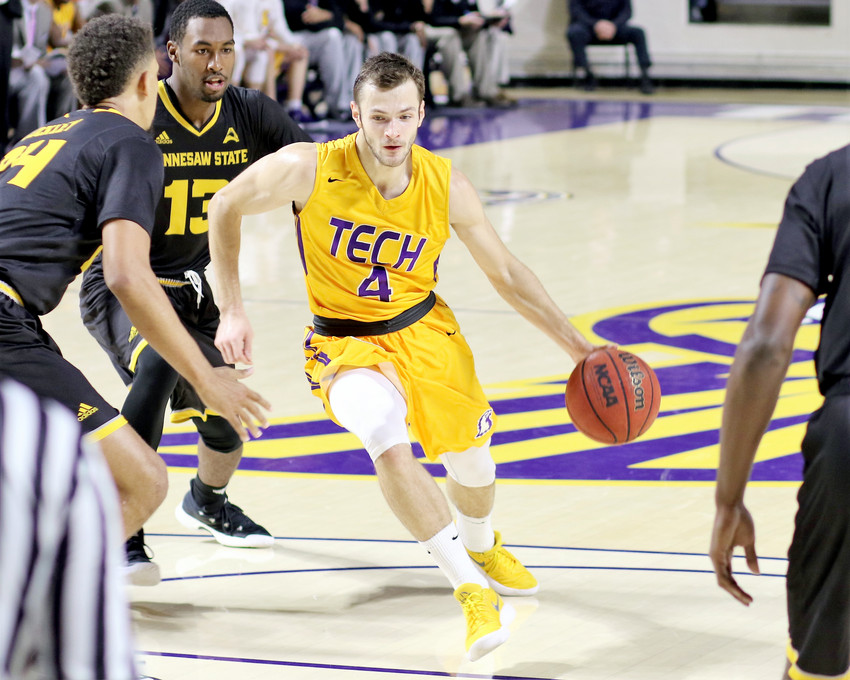 Tennessee Tech's Aleksa Jugovic, right, splits two Kennesaw State defenders during a game at the Hooper Eblen Center earlier in November.