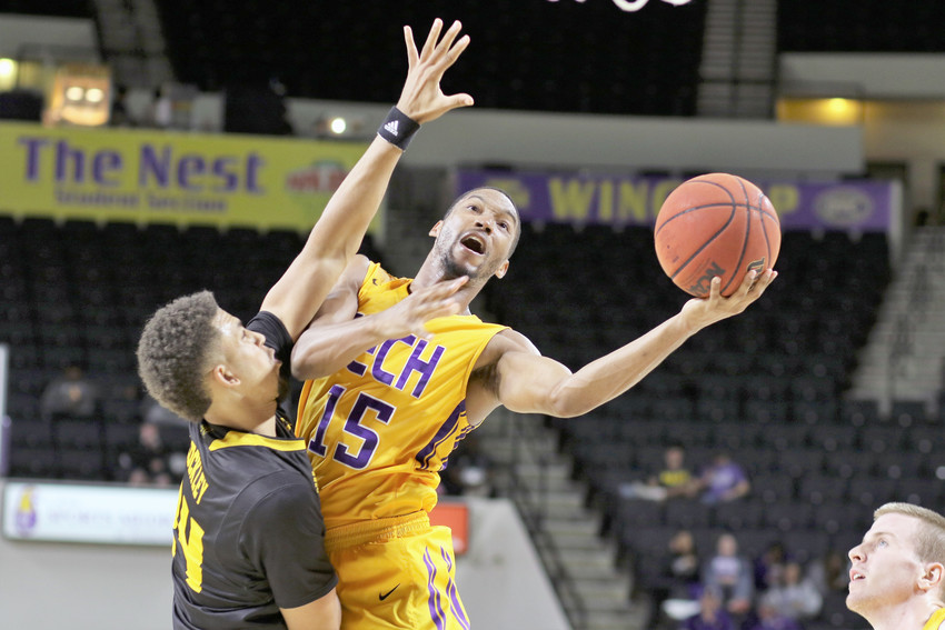 Tennessee Tech's Curtis Phillips Jr., right, puts up a layup around a Kennesaw State defender during a game at the Hooper Eblen Center earlier in November.