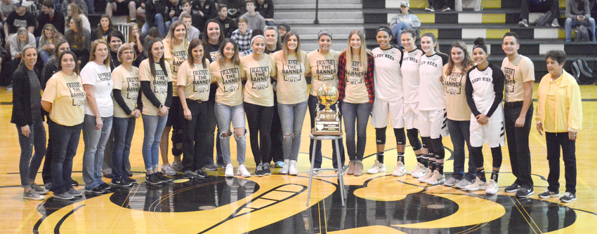 Upperman High School Basketball Coach Dana McWilliams, front row, fifth from left, was honored along with her 2017 state championship team during ceremonies Tuesday night prior to Upperman's twinbill with visiting Bledsoe County. UHS capped the evening by winning both games.