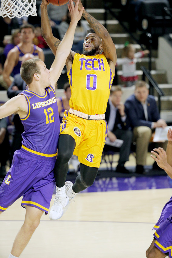 Tennessee Tech's Shaq Calhoun, right, throws down a dunk over a Lipscomb defender during the Golden Eagles' 86-80 win on Wednesday night at the Hooper Eblen Center.